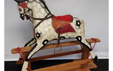 A 19th century wood and hand painted rocking horse, fitted w...