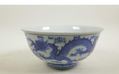 A Chinese blue and white porcelain bowl decorated with two d...