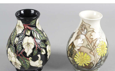 A Moorcroft pottery vase, in Dandelion pattern, together with another similar example in Mountain Gold pattern. (2).