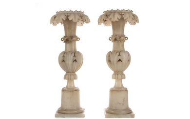 A PAIR OF LATE 19TH CENTURY ALABASTER ALTAR CANDLESTICKS