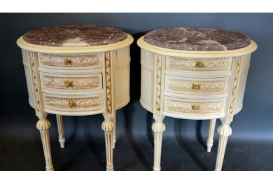 A Pair of French Cream Painted Oval Chests, the variegated m...