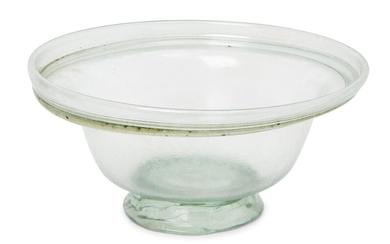 A Roman pale green glass bowl with collar rim and tooled ring base, circa 4th Century A.D., 13cm diam., 6.3cm high Provenance: Acquired by the current owner's grandmother in the 1970s.