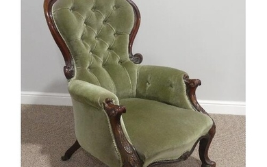 A Victorian walnut gentleman's Armchair, with leaf capped ca...