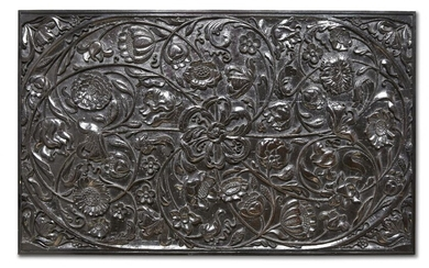A large carved ebony panel, Batavia or Ceylon for the Dutch market, 1680-1720, 58 x 94cm. This fine quality, ebony panel, deeply carved in half relief, depicts a variety of flowers including tulips and sunflowers attached to tendrils which swirl...