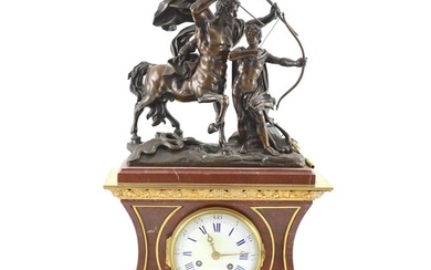A late 19th century French bronze mounted rouge marble mante...