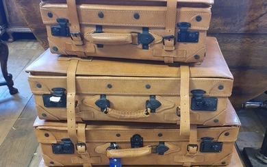A set of four graduated leather suitcases by Giovanni, the l...