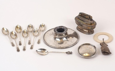 A silver inkwell, Birmingham, c.1916, A & J Zimmerman, with monogram to lid (damaged), together with a baby's rattle with horn ring and white metal rabbit dependent; a silver coffee spoon with devil terminal, Sheffield, c.1907; a set of seven...
