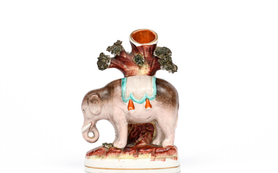 A small Staffordshire spill vase figure of an elephant 19th century