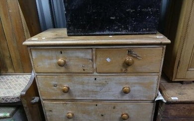 A vintage pine Chest of Drawers, with two short drawers over...