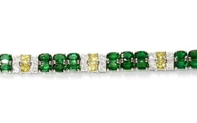 A white gold two row chrome diopside, yellow sapphire and diamond line bracelet