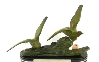 AN ART DECO SPELTER AND MARBLE BIRD SCULPTURE Two spelter co...