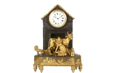 AN EARLY 19TH CENTURY FRENCH EMPIRE PERIOD GILT AND PATINATED BRONZE FIGURAL MANTEL CLOCK 'THE MILKMAID'