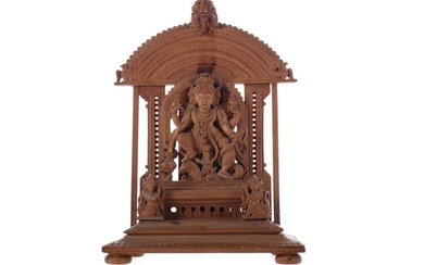AN EARLY 20TH CENTURY INDIAN CARVED SANDALWOOD FIGURE OF A DEITY