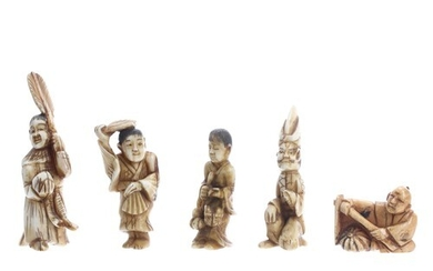 Four small Japanese stained ivory figural okimono and a nets...
