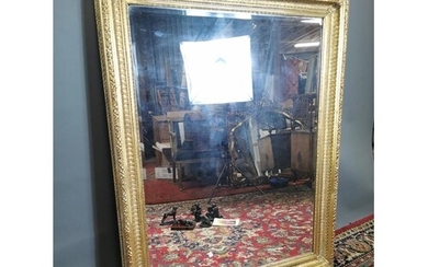 Gilt wall mirror with bevelled plate in the Victorian style....