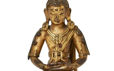 The following fifty lots (36-85) are The Property of a Gentleman A Sino-Tibetan gilt-bronze figure of a bodhisattva, 17th/18th century, finely cast seated in dhyanasana on a double-lotus base, his hands resting in his lap holding a vessel, the...