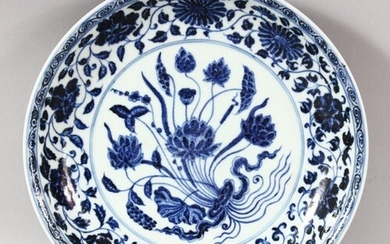 A CHINESE BLUE AND WHITE PORCELAIN DISH, painted with flower...