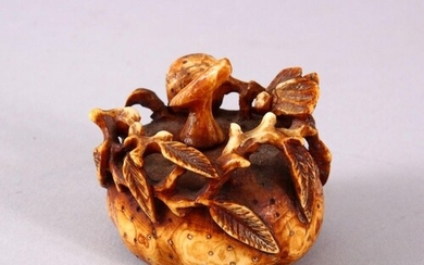 A CHINESE CARVED BONE PUMPKIN FORMED SNUFF BOTTLE, with carv...