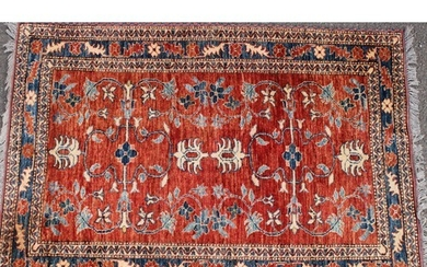 A Middle Eastern rug, worked in the traditional manner, 152c...