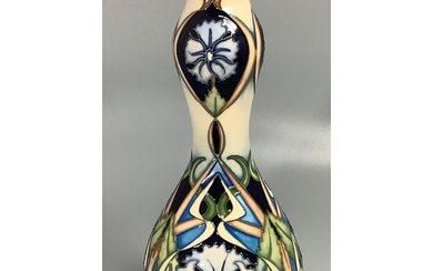 A Moorcroft pottery vase of double-gourd form, decorated in ...