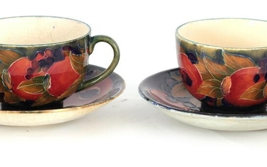 A PAIR OF EARLY MOORCROFT BURSLEM CABINET CUPS AND
