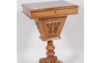A Victorian walnut workbox with lift up top and pierced bask...