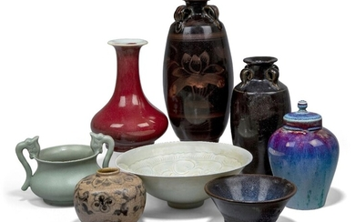 A group of Chinese ceramics, 20th century, comprising a copper red vase, a Qingbai bowl, a celadon twin-handled vase, a flambé jar and cover, two black-glazed vases, a teabowl and a crackle-glazed jar, 6.3cm-25cm high (8)