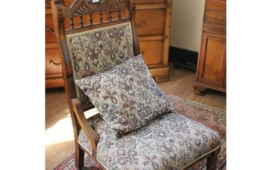 A late Victorian carved wood grandmother type salon chair, o...