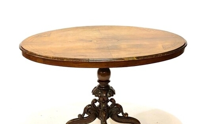 A late Victorian marquetry inlaid oval tilt top breakfast ta...