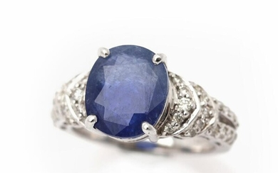 A sapphire ring set with an oval-cut sapphire weighing app. 5.54 ct. flanked by numerous diamonds, mounted in 14k white gold. Size 54. – Bruun Rasmussen Auctioneers of Fine Art