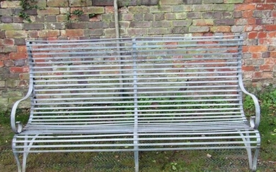 A sprung galvanised steel garden bench with scrolled back, a...