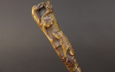 Cane with gnarled wooden shaft. Horn knob carved with the fable of the crow and the fox. Height 93 cm