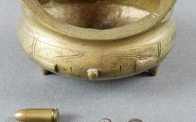 Group of brass bowl, bullets, buttons