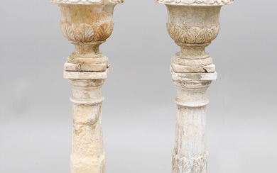 POSTAM WITH URNORS, A PAIR, probably the end of the 19th century.