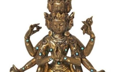 Property of a Gentleman (lots 36-85) A Sino-Tibetan gilt-bronze turquoise inlaid standing figure of Avalokiteshvara, 19th century, depicted with eleven heads arranged in five tiers, the top with a small head of Amitabha Buddha, above a slender body...