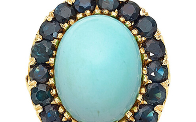 Turquoise, Sapphire, Gold Ring The ring features an oval-shaped...