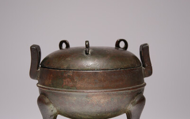 A CHINESE BRONZE TRIPOD INCENSE BURNER AND COVER