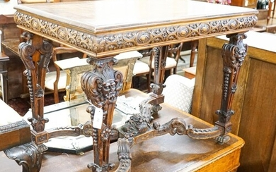 A Flemish carved walnut and beech centre table, width 100cm,...