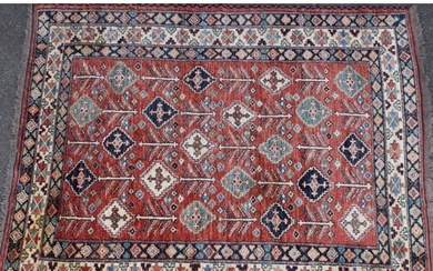 A Middle Eastern woollen carpet, worked in the traditional m...