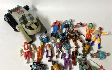 A collection of 1980s and 1990s action figures, to include L...
