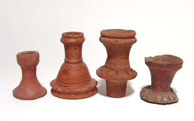 A group of 4 Islamic redware spout fragments