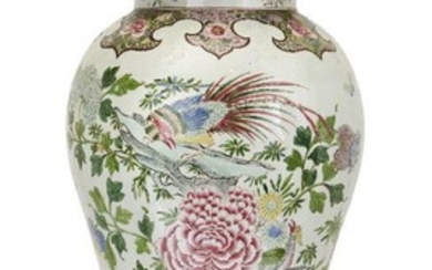 A large Chinese export style baluster form vase and cover, possibly Samson, 20th century, decorated to the body with flora and fauna, the cover with Dog of Fo finial, on carved hardwood stand, 112cm high overall
