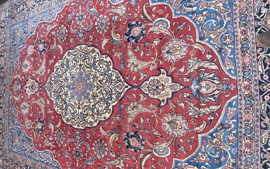A late 20th century Middle Eastern red and blue ground...