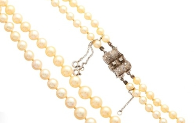 A mid 20th century graduated cultured pearl two-row necklace...