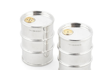 A novelty pair of silver 'oil drum' salt and pepper shakers