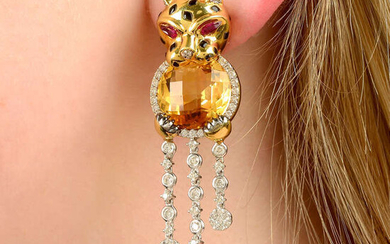 A pair of diamond, citrine, onyx and ruby panther earrings.