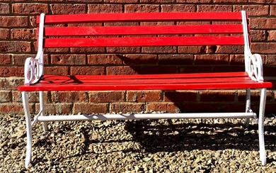 A red painted wooden and cast iron garden bench