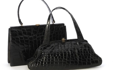 A set comprising of two bags of black alligator skin with matching wallets. (4) – Bruun Rasmussen Auctioneers of Fine Art
