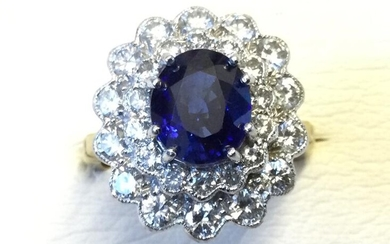 An 18ct yellow gold sapphire & diamond ring, the...