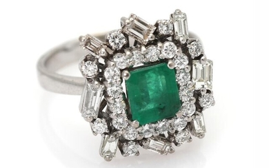 An emerald and diamond ring set with an emerald-cut emerald encircled by numerous baguette- and brilliant-cut diamonds, mounted in 18k white gold. Size 59. – Bruun Rasmussen Auctioneers of Fine Art
